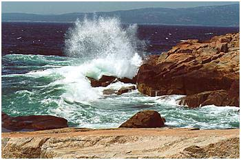 photo of rocks and wave spray